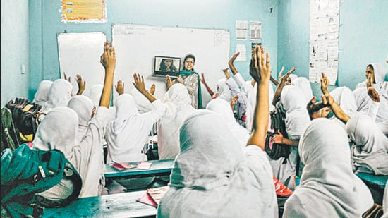 Students in a Hyderabad classroom talk to Ruth Sequeira, a top human resources professional who is one of the 15 women profiled in Varsha Adusumilli's book, Wonder Girls (Wonder Girls Foundation Programme)