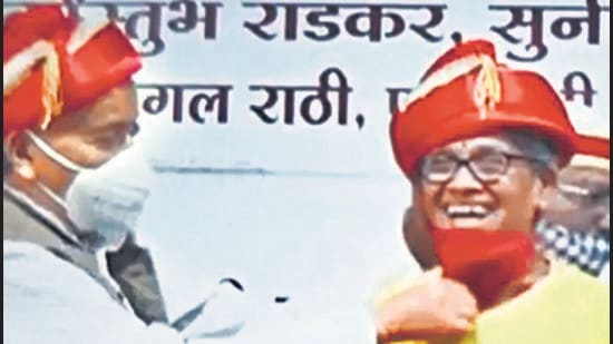 Bhagat Singh Koshyari, Maharashtra governor, courted a controversy after he took off the face mask of a woman whom he felicitated at an event in the city on Friday. (Video Grab)