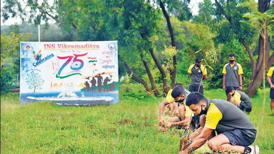 The crew of INS Vikramaditya conduct a plantation drive of 75 saplings on the occasion of the 75th Independence Day celebrations, in Karnataka's Karwar, on Sunday. (ANI)