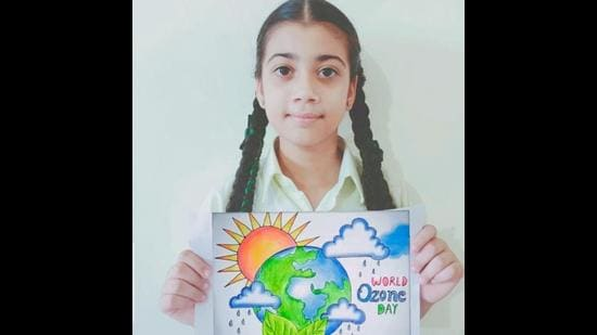 A student of Green Grove Public School, Ludhiana, showcasing a poster made by her. (HT Photo)