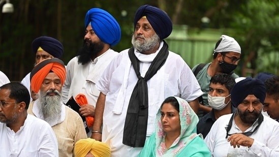 SAD president Sukhbir Singh Badal and party member Harsimrat Kaur Badal bottom) take part in a protest march against the farm laws.