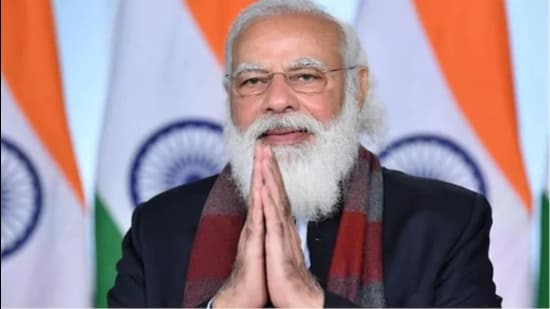 """'This will be possible when we give as much importance to corona precautions as much as we have given for vaccinations,"""" the prime minister said. (PTI)"""