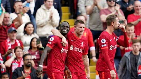 Liverpool's Sadio Mane, left, celebrates with James Milner.(AP)