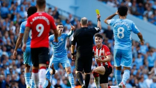 Southampton's Tino Livramento is shown a yellow card by referee Jonathan Moss.(Action Images via Reuters)