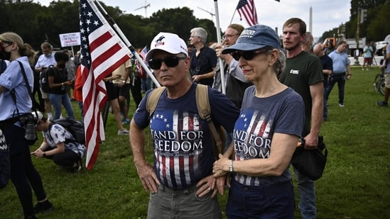 """Organizers of the """"Justice for J6"""" rally -- who said they wanted to draw attention to those held over the riot who did not commit violent offenses -- had received a permit for 700 people to gather near the Capitol's reflecting pool, but far fewer showed up.(AFP)"""
