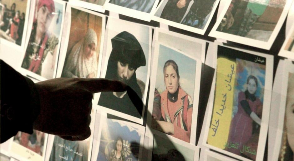 Activists collect photos of the missing Yazidi in their efforts to rescue them(LOLAV MEDIA AB 2021)