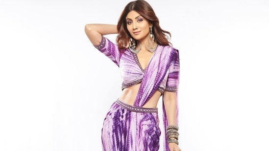 Shilpa Shetty raises the hotness quotient in a purple tie and dye saree with front slit
