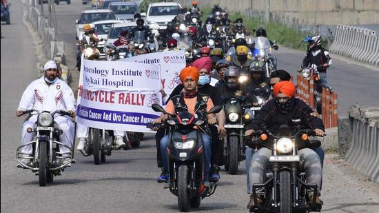 Residents, along with Punjab Police Academy, Phillaur, carrying out a motorcycle rally in Ludhiana on Sunday. (Harsimar Pal Singh/HT)