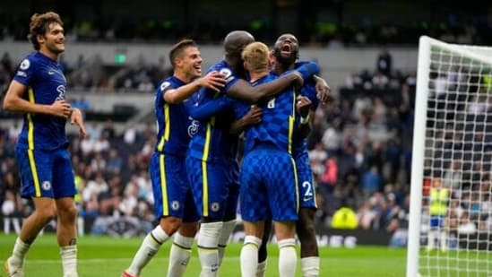 Chelsea's Antonio Rudiger, right, celebrates after scoring his side's third goal during the English Premier League soccer match between Tottenham Hotspur and Chelsea at the Tottenham Hotspur Stadium in London, England, Sunday, Sep. 19, 2021. (AP Photo/Matt Dunham)(AP)
