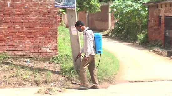 A health personnel at work at Kursauli village in Kanpur. (ANI photo)