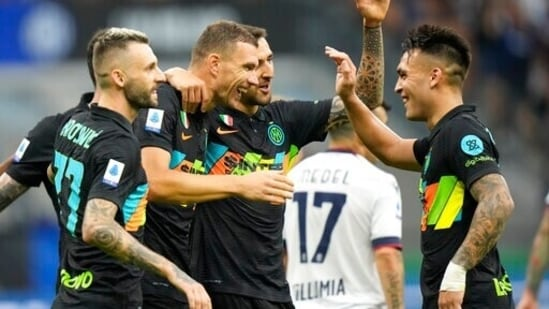 Inter Milan's Edin Dzeko, center, celebrates with teammates after scoring his side's 5th goal during a Serie A soccer match between Inter Milan and Bologna, at the San Siro stadium in Milan, Italy, Saturday, Sept. 18, 2021.Inter Milan beat Bologna 6-1.((AP)