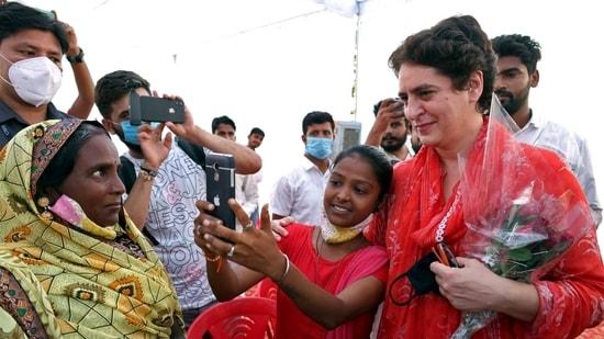 A girl takes a selfie with Priyanka Gandhi Vadra in Rae Bareli on Sunday.