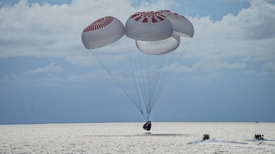 The quartet of newly minted citizen astronauts comprising the SpaceX Inspiration4 mission safely splashes down in SpaceX's Crew Dragon capsule off the coast of Kennedy Space Center, Florida, USA