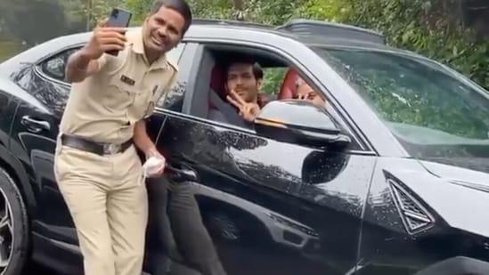 Kartik Aaryan with a policeman.