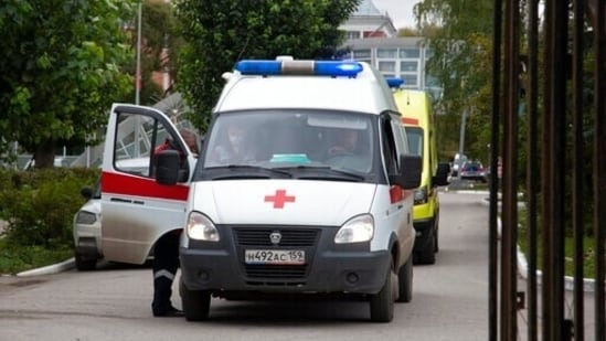 Ambulances parked at the Perm State University in Perm, after the teenage gunman opened fire on Monday. (AP Photo/Anastasia Yakovleva)