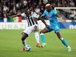Udinese's Samir, left, and Napoli's Victor Osimhen in action during the Serie A soccer match between Udinese and Napoli, at the Dacia arena in Udine(AP)
