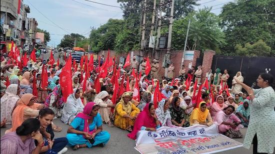 Dalit women holding a protest march to seek implementation of the Land Ceiling Act in Punjab, at Sangrur on Tuesday. (HT Photo)