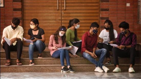 Students at Delhi University campus after DDMA allowed DU to reopen on September 15. The university has formed a National Education Policy (NEP) committee to frame syllabi for six new interdisciplinary courses. (Sanchit Khanna/HT Photo)