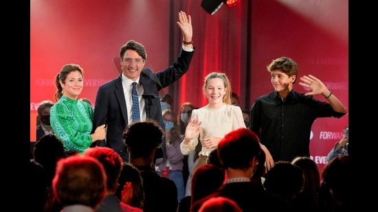 Canada's Prime Minister Justin Trudeau, accompanied by his wife Sophie Gregoire and their children Ella-Grace and Xavier, waves to supporters during the Liberal Party election night party in Montreal, Quebec, Canada, September 21, 2021. His party has won the Canada elections, according to the latest Canada election results. (REUTERS)