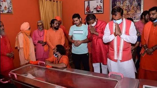 Deputy Chief Minister Keshav Prasad Maurya paying his last respects to Mahant Narendra Giri at Baghambari Math ashram in Prayagraj on Tuesday. (Anil Kumar Maurya/HT photo)