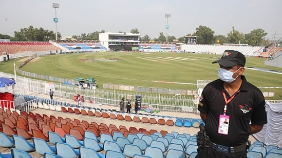 A security forces personnel is seen in the cricket stadium following the cancellation of cricket series between Pakistan and New Zealand.