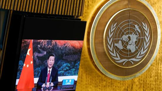 Chinese President Xi Jinping speaks remotely during the 76th UNGA at UN Headquarters in New York on September 21, 2021. He said China will no longer build new coal-fired power projects abroad in view of the need to address climate change. (REUTERS)