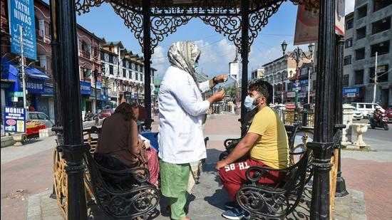 A medic prepares to administer a dose of Covid-19 vaccine to a beneficiary in Srinagar on Wednesday. (PTI)