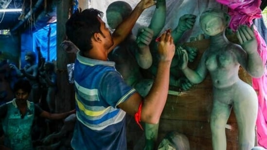 With Durga Puja just around the corner, artists all over India are giving finishing touches to the idols before they are taken to pandals, temples and homes where the rituals take place.(AP)