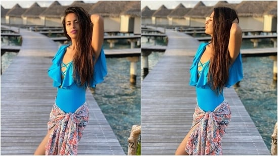 Avika chose a sky blue monokini for this image and teamed it with a printed sarong and open locks. The bodycon monokini came with frilled sleeves and a plunging neckline with overlapping straps. As for the pastel-coloured sarong, it features a multi-coloured print.(Instagram/@avikagor)