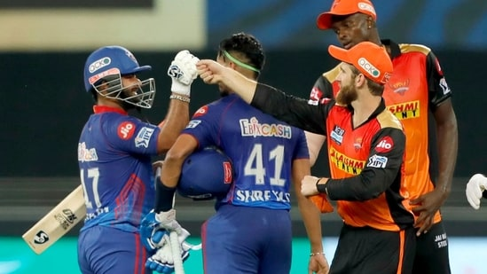 Delhi Capitals and Sunrisers Hyderabad players doing handshakes with each others.(ANI)