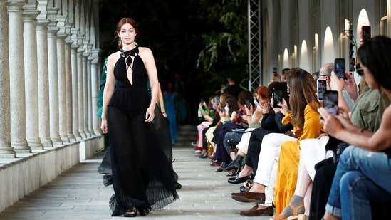 Model Gigi Hadid presents creation from the Alberta Ferretti Spring/Summer 2022 collection during Milan Fashion Week in Milan, Italy