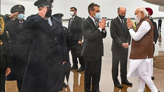 Indian Prime Minister Narendra Modi being received by the dignitaries, on his arrival, in Washington DC, on Thursday. Prime Minister Narendra Modi will join US President Joe Biden, Australia's Scott Morrison and Japan's Yoshihide Suga for the first in-person summit of the Quad leaders on Friday. (PTI)