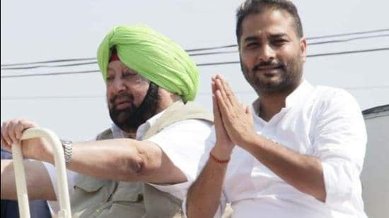 A file photo of Congress' Jalalabad MLA Raminder Singh Awla with former CM Amarinder Singh. Fazilka officer claims that threats are being issued to him by the MLA, who, in turn, has accused the officer of harassing sarpanches in his area. (HT photo)