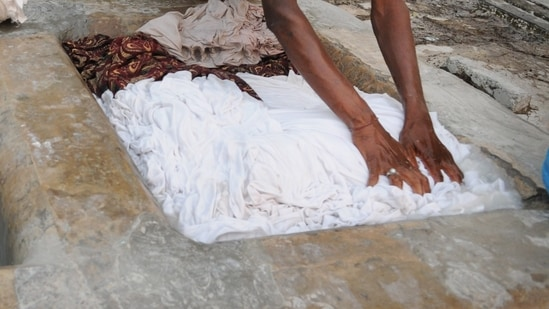 Lalan Kumar, 20, will have to buy detergent and other items needed to provide six months of free laundry services to about 2,000 women in the village of Majhor in Bihar state, under the ruling made Wednesday.(HT File)