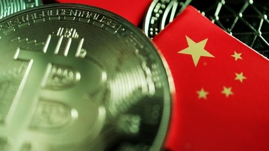 A Chinese flag is seen among representations of Bitcoin and other cryptocurrencies.(REUTERS)