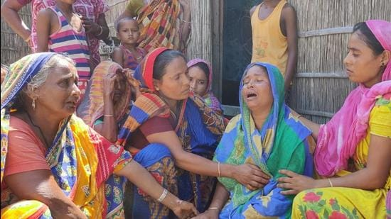 Deceased Shakh Farid's mother (third from right) being consoled by relatives and neighbours on Friday. Day after the violence in Assam, many residents recall the horror. (Utpal Parashar HT Photo)