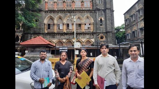 Kharghar Forum members outside the High Court. They have filed write petition against Panvel City Municipal Corporation for double taxation (HT PHOTO)