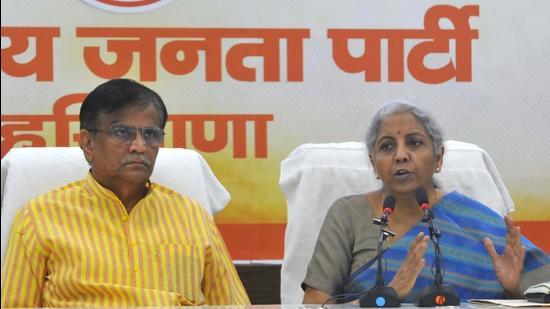 Union finance minister Nirmala Sitharam addressing a press conference in Chandigarh on Friday as Haryana BJP chief OP Dhankar looks on. (Keshav Singh/HT)