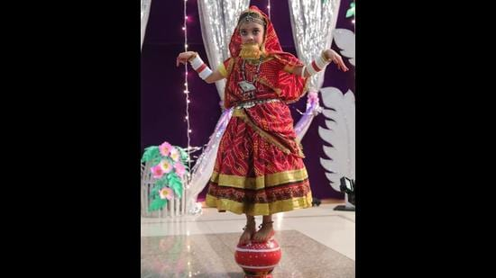 A student of BCM Arya Model Senior Secondary School giving a dance performance during the opening ceremony of the school's annual cultural fiesta in Ludhiana on Friday. (HT Photo)