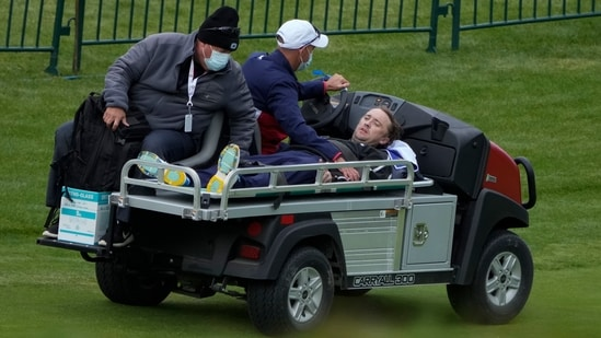 Actor Tom Felton is helped after collapsing on the 18th hole during a practice day at the Ryder Cup at the Whistling Straits Golf Course Thursday.(AP)