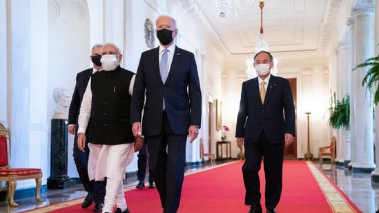 US President Joe Biden walks to the Quad summit with Prime Minister Narendra Modi, Australian Prime Minister Scott Morrison, and Japanese Prime Minister Yoshihide Suga.