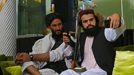 Taliban fighters take their selfie with a mobile phone inside the home of the Afghan warlord Abdul Rashid Dostum in the Sherpur neighborhood of Kabul.(AFP)