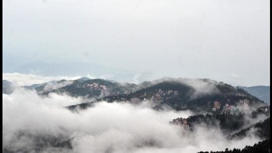 Himachal Pradesh capital Shimla is engulfed in clouds after a day of heavy rain. Nine passengers had a narrow escape after the rail car ferrying them from Kalka to Shimla ran off track due to a landslide near Barog on Thursday. (Deepak Sansta/HT)