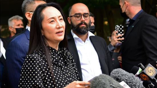 Huawei chief financial officer Meng Wanzhou (centre) talks to media at British Columbia Supreme Court after her extradition hearing ended in her favour, in Vancouver British Columbia, Canada on Friday. (AFP)