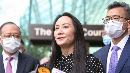 Huawei Technologies chief financial officer Meng Wanzhou speaks to media outside the British Columbia Supreme Court following a hearing on her release in Vancouver, Canada, on Friday. (REUTERS)