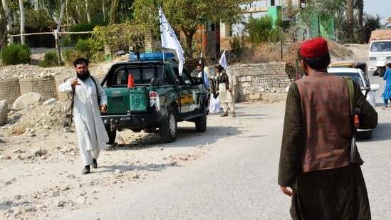 Taliban members inspect the site of a blast in Jalalabad.(AFP Photo)