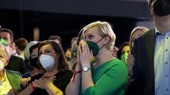 Attendees react to the first exit poll for the German federal election in Berlin, Germany(Bloomberg)