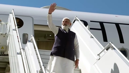 Prime Minister Narendra Modi waves as he emplanes for India after concluding his US visit,(ANI Photo)