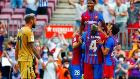 Barcelona's Ansu Fati celebrates after scoring his side's third goal during a Spanish La Liga soccer match between FC Barcelona and Levante at the Camp Nou stadium in Barcelona, Spain, Sunday, Sept. 26, 2021. (AP Photo/Joan Monfort)(AP)