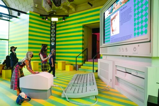 People visit the Gucci unveiled new on-line concept store, called Gucci Vault(AP)